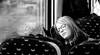 travelling or dreaming? (Ommation (Vasilis Benakis)) Tags: travel blackandwhite woman girl train mirror belgium blond seats teenager percing glassew canon100d