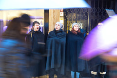 Choir in the cold (Huey Yoong) Tags: christmas street winter italy snow choir umbrella europe italia singing streetperformers streetphotography teenagers verona snowing natale busking passerby streetperformance carolling northernitaly travelphotography peopleportraits christmascarols peoplephotography nikond600 nikkor28300mmvr regionaleveneto