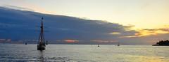 As dusk settles, warmed by the tropical sun's final glow. (paul.trottier) Tags: sunset sun west colour art beautiful pier photo nikon key glow colours arty artistic florida dusk ambientlight creative tropical colourful sailboats nikkor buoys 28300mm d610 settles magically glowfromlights paultrottier