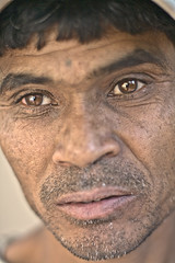 A Heart of Gold (Ashesh Ambasta) Tags: travel portrait india gold eyes mine expressive journalism journalistic