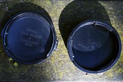 The originals (Arne Kuilman) Tags: original detail amsterdam nikon letters caps olympus font 70s covers 1970s nikkor protection jum madeinjapan em10 lenscaps lf1 nipponkogaku type4g