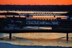Four and a half bridges (beyondhue) Tags: bridge winter sunset sky orange ontario canada reflection ice wales river ottawa prince champlain gatineau melt portage chaudiere beyondhue