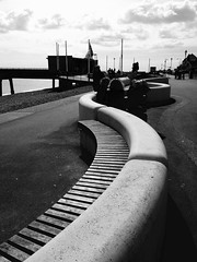Deal UK (jcbkk1956) Tags: street people blackandwhite silhouette contrast bench mono pier kent sitting curves seats promenade deal contrejour contrejoure iphone5
