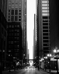 Chicago sunset (Evan Tchelepi) Tags: city sunset urban blackandwhite chicago building film architecture contrast 35mm lights tmax analogue halfframe penft 38mm