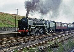 "70013 at Hellifield station, Yorks. 28th July 1968.   ""Farewell to B.R. Steam"" Rail Tour (photo 1 of 7) (Brit 70013 fan) Tags: br pacific yorkshire railway steam british 1968 railtour standard railways steamengine britannia olivercromwell britishrailways hellifield 70013 farewelltobrsteam"