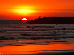 SUNSET AT THE BEACH (robbiedest) Tags: ocean travel sunset sea orange sun beach swimming swim silhouettes