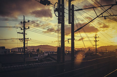 Sunset light from the bullet train... (NOAC_) Tags: lighting travel blue light sunset cloud beautiful yellow japan clouds train japanese lights tokyo golden kyoto dusk snapshot hour infrastructure bullet traveling cloudscape pentaxk5iis