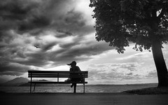 (Magdalena Roeseler) Tags: street people bw monochrome clouds switzerland streetphotography zug sw lonely zugersee strassenfotografie
