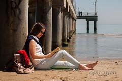 Voglia di mare (Marco Nanni) Tags: sea portrait italy girl italia mare libro ritratto lettura spiaggia piedi abruzzo ragazza sabbia pontile nudi vasto abruzzi