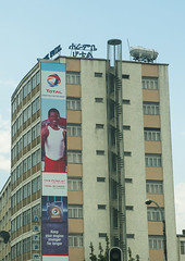 Total giant billboard with haile gebreselassie on side of building, Addis abeba region, Addis ababa, Ethiopia (Eric Lafforgue) Tags: africa street city color building sign vertical facade giant poster outdoors exterior capital champion large nobody nopeople billboard advertisement business hero huge ethiopia addisababa signboard enormous hornofafrica advertise eastafrica thiopien etiopia abyssinia urbanscene ethiopie etiopa hailegebreselassie buildingexterior addisabeba  etiopija ethiopi  ethnicgroup etiopien etipia  etiyopya          addisabebaregion ethio163179