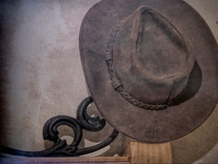 Hat on the Headboard (clarkcg photography) Tags: light hat leather metal wall bed bedroom headboard western
