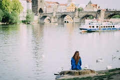 The Blue Jacket (freyavev) Tags: city bridge blue woman water girl river 50mm boat prague prag praha swans serene charlesbridge vltava karlovmost