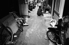 Innocence (Purple Field) Tags: contax tvs carl zeiss variosonnar 28mmf3556mmf65 fuji neopan iso400 presto bw monochrome film analog 35mm jakarta indonesia street alley walking bicycle graffiti