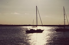 Shimmer (cianwarren) Tags: street sunset sea sun abstract silhouette pier boat over exposed shimmer dun laoghaire