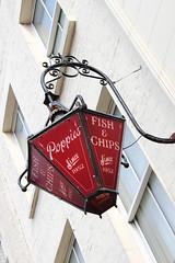 image (Kathi Huidobro) Tags: bestofbritish streetfurniture lantern poppies fishchips londonshops shopsign oldlondon eastlondon traditional british londoners facade red signage signs heritage urban streetphotography