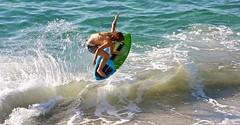 Erin Carpenter airborne (cjbphotos1) Tags: ocean california beach waves sandiego action lajolla wipeout skimboarding thewall boarding skimming