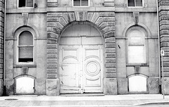 Old Door on the Coppley Building (Bill Smith1) Tags: hc110b olympusom4 hamiltonon berggerbrf400 zuiko50f14lens filmshooterscollective spring2016 billsmithsphotography