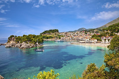 Beautiful panoramic view of Parga, Greece. (TG123456) Tags: city travel blue sea summer vacation people seascape tourism beach nature water beautiful swimming umbrella relax landscape island greek bay coast boat sand europe mediterranean european scenic hellas sunny location tourists resort greece exotic shore tropical destination rest summertime balkans sivota piso ionian parga syvota epiros sunbeds epirus ipiros kryoneri