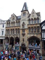 Shops on Eastgate Street, 2016 Jun 12 (Dunnock_D) Tags: uk england giant children model unitedkingdom britain crowd flags parade queen celebration chester celebrations rows procession waving unionjack unionflag crowds elizabethii hermajesty eastgatestreet queens90th