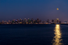 Full buck moon over San Diego city skyline (slworking2) Tags: ocean california city moon reflection water skyline night us downtown unitedstates pacific sandiego fullmoon nighttime moonrise