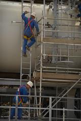 Scaffolders-2 (algimantas_tirlikas) Tags: auto building work pipe montage pipeline cisterns rafinery