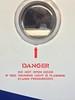 DANGER (frankrolf) Tags: airplane danger cabin pressurized miltonglaser glaserstencil type:face=glaserstencil