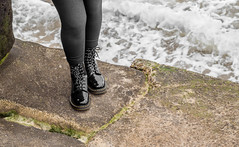 Black patent leather 8 hole 1460. and the sea. (CWhatPhotos) Tags: pictures camera girls sea woman black water leather stone that four photography foto hole legs image boots artistic pics walk dr leg picture pic olympus images womens holes have photographs photograph fotos sole marten which soles dm eight docs contain bouncing airwair thirds martens patent dms onthe 1460 cwhatphotos