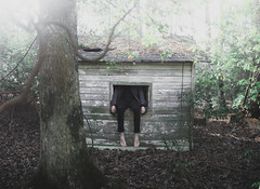 Dissociate III (Weston Clark) Tags: trees light portrait sun selfportrait tree green abandoned feet forest dark hands shed concept conceptual dissociate