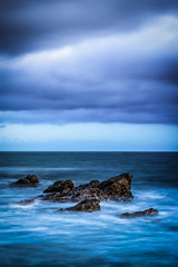 Reef Point - Coming Up For Air (www.karltonhuberphotography.com) Tags: longexposure light sky seascape beach water clouds moody relaxing peaceful pacificocean southerncalifornia somber tranquil theoc californiacoastline seafoam softlight earlyevening 2016 sidelight southcounty verticalimage reefpoint denseclouds silkywater offshorerocks karltonhuber