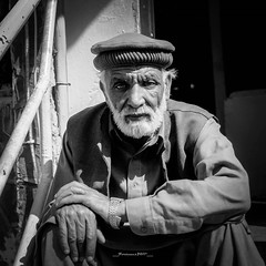 Old man in Murree (Fortunes2011. Haunting Nostalgia) Tags: portrait people white man face hat beard eyes oldman grace human cap gentleman murree portraitportraiturefaceeyescloseupfacialhairmaleportrait fortunes2011nikon