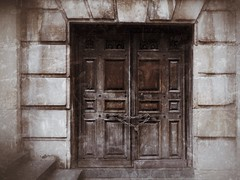 The Door at St. Paul's (Feldore) Tags: old england london english st sepia vintage wooden cathedral pauls historic chain textures aged padlock locked enigmatic atget