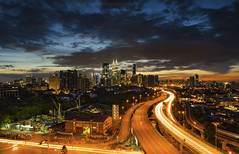 Blue Hour Dramatic Sky (gilbertchuachian_siong) Tags: city travel sunset sky building tourism architecture nikon highway asia cityscape flat cloudy dusk famous dramatic visit malaysia destination bluehour kualalumpur lightrail interest klcc ampang selangor citylight nikond7000