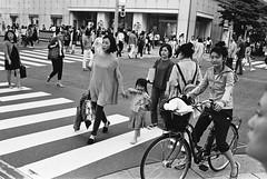 Ginza, Tokyo (fabiolug) Tags: street leica people blackandwhite bw film bike bicycle japan 35mm japanese tokyo ginza blackwhite asia crossing voigtlander streetphotography rangefinder fujifilm mp acros acros100 filmphotography leicamp fujifilmneopanacros100 fujifilmacros100 voigtlandernokton35mmf14 voigtlandernoktonclassic35mmf14 voigtlander35mmf14 believeinfilm
