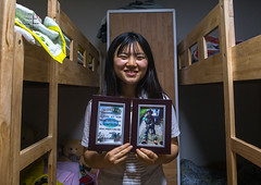 North korean teen defector showing an army training diploma, National capital area, Seoul, South korea (Eric Lafforgue) Tags: portrait woman house home smiling horizontal proud asian happy photography living student bed bedroom education asia diploma candid interior room refugee graduation pride front indoors teen achievement seoul teenager inside hispanic graduate satisfaction southkorea youngadult showing success confident oneperson graduated graduating defector 1819years lookingatcamera northkorean 1617years waistup 1people nationalcapitalarea colourpicture koreanscript koreanethnicity sk162390