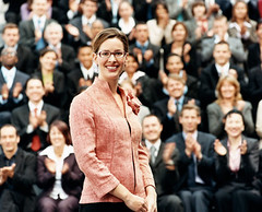 businesswoman-presenting-before-big-group-ThinkstockPhotos (sarahmepstein) Tags: businesswoman presenting presenter professional executive thinkstock confident smiling powerful important