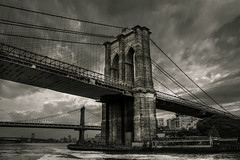 Murmurous ( Esther ) Tags: street new york city travel bridge light sunset summer sky urban usa sun white ny black building art water architecture brooklyn night clouds canon river photography cityscape manhattan perspective hdr