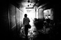 Osaka Tsuruhashi market early morning (maxwellkimi) Tags: osaka tsuruhashi shutter market woman silhouette