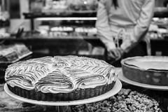 nice cake (Kim S. Landgraf) Tags: street city people urban blackandwhite bw window public cake candid streetphotography olympus bakery freiburg 25mm em5