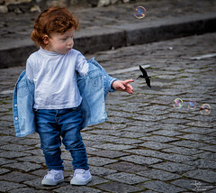 Sacre-Coeur, Monmartre, Paris- (by Amy Davies, Plymouth, MA) Tags: paris france march toddler sweet bubbles montmartre sacrecoeur redhead younggirl 2015 cobblestonestreet basilicaofthesacredheartofparis