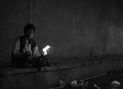 Man with Fire (sparksy2k14) Tags: blackandwhite india canon fire eos delhi homeless tunnel beggar 5d
