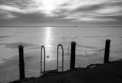 Chicago Waterfront (Dalliance with Light (Andy Farmer)) Tags: winter sky bw chicago ice water silhouette dawn harbor illinois unitedstates lakemichigan il lakefront breakwall
