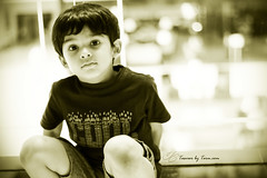 Bokeh (TasveerByTaru) Tags: light boy portrait people bw baby india white black color art boys monochrome smile face by kids contrast canon dark children outdoors photography rebel 50mm photo kid interesting toddler infant colorful exposure babies photographer dof child image bokeh candid indian young naturallight pic laugh mumbai infants t3i taru indianchild colorimage incredibleindia tasveer indiacolorful tasveerbytaru