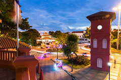 Dutch Square after sunset (lunarlynx) Tags: road street old city longexposure travel blue light sunset red building green tower clock tourism colors dutch yellow architecture night square town colorful asia cityscape dusk famous colonial illumination landmark scene illuminated trail malaysia destination lantern rickshaw melaka malacca touristic