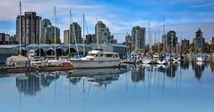 Coal Harbour (Images by Christie  Happy Clicks for 2016!) Tags: ocean seascape canada skyline vancouver boats dock nikon downtown bc yacht mooring slip stanleypark sailboats boathouse seashore coalharbour moored d5200