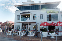 sundaychill17 (WITHIN the FRAME Photography(4 Million views tha) Tags: street windows tourism hermanus corner southafrica restaurant cafe fuji chairs tables balconies umbrellas xt1