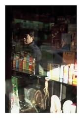 (Michael Raymond Lund) Tags: street new york city nyc light shadow portrait urban man color film face 35mm photography chinatown fuji candid slide olympus fujifilm om fujichrome provia e6 100f 4ti