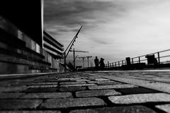 walk. (HansEckart) Tags: street shadow blackandwhite bw monochrome silhouette canon hamburg sw schatten perspektive weg 18mm kopfsteinplaster