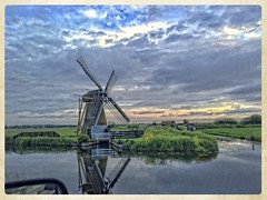 On the road again (gill4kleuren - 11 ml views) Tags: road sunset reflection netherlands windmill colors clouds molen