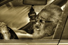 On the Prowl (Jon Scherff) Tags: people sunglasses sepia beard driving cigarette oldman smoking facialhair oldpeople peoplewatching