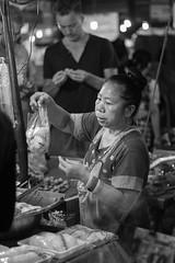 Barter (ruckyletsrockBS) Tags: street monochrome night blackwhite market streetphotography streetportrait